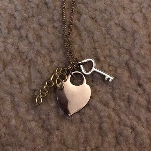 Jewelry - *sold* Gold and Silver Charm Necklace